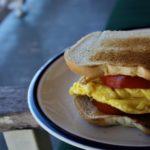 An Awkwardly Large Yet Delicious Sandwich: Toasted Egg & Tomato.